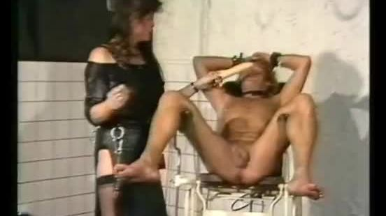 Mistress wearing leather puts dildo in the ass of screaming tied up slave